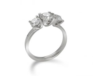 trilogy engagement ring diamond and platinum claw setting