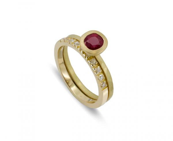 gold ruby ring with wedding band with micro set diamonds in 18ct yellow gold