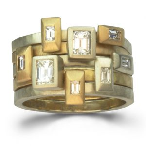 Bespoke stacking rings in white and yellow gold with emerald cut diamonds