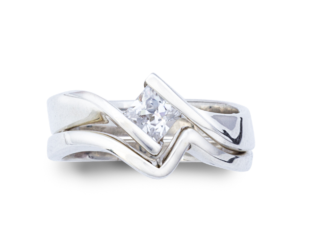 princess cut twist engagement ring with fitted wedding