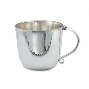 silver christening cup with forged and scrolled handle.
