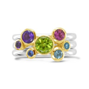 stacking rings 18ct yellow gold and silver with peridot, blue topaz, amethyst and iolite