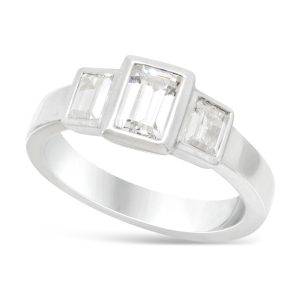 trilogy ring with emerald cut diamonds