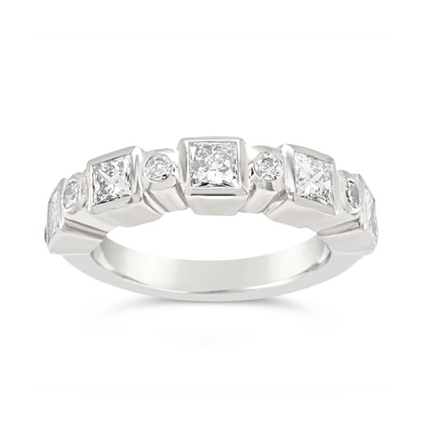 Contemporary eternity ring alternating suare and round diamonds in platinum