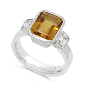 Trilogy Ring With Emerald Cut Orange Topaz and Diamonds