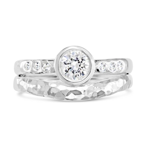 Hammered engagement ring in platinum set with a 0.5ct round diamond