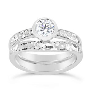 Hammered engagement ring with round diamond handmade in platinum