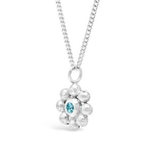 silver flower pendant with blue topaz