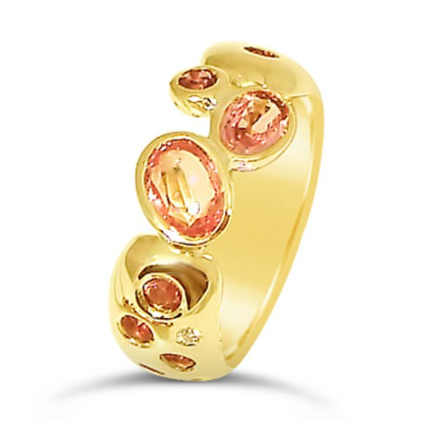 Pink tourmaline ring in 18ct yellow gold with the stones set in a scatter pattern
