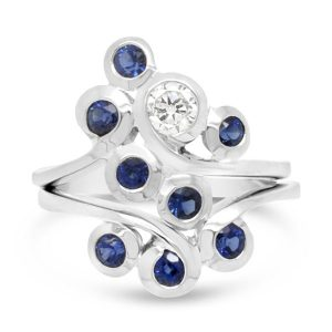 sapphire ring, stacking swirl design with diamonds in platinum