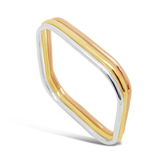 three gold bangles rose gold yellow gold white gold