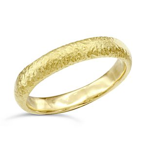 yellow gold textured wedding ring
