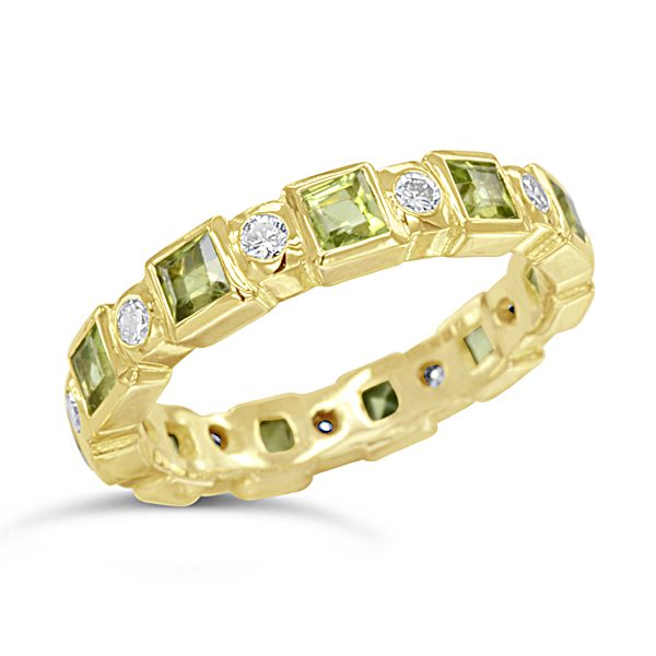 peridot eternity ring in 18ct yellow gold with diamonds