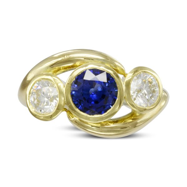 gold sapphire and diamond inwards spiky trilogy ring