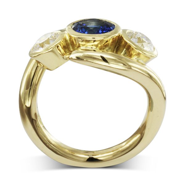 bespoke gold sapphire and diamond inwards spiky trilogy ring