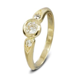 Solitaire diamond leaf motif engagement ring