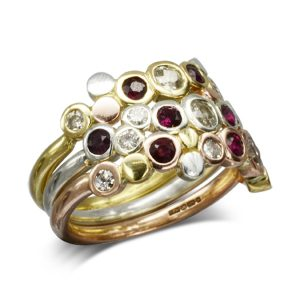 Three colour gold ruby stacking rings