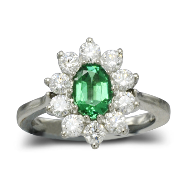 A Traditional emerald and diamond cluster ring