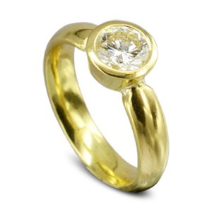 Contemporary Gold Diamond solitaire Engagement Ring