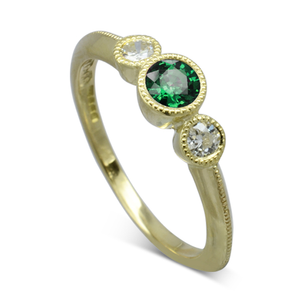vintage trilogy engagement ring with emerald