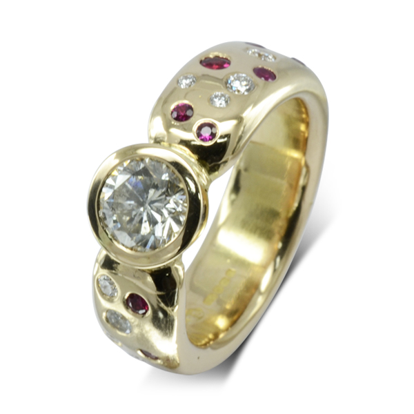 Ruby and Diamond scatter solitaire ring