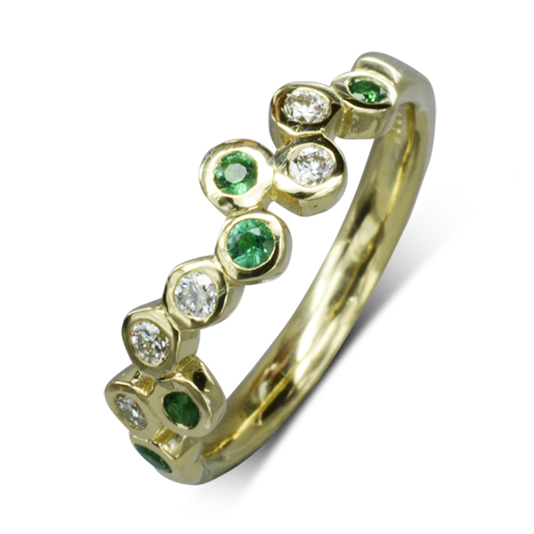 Unusual Gold Eternity Rings with emeralds and diamonds