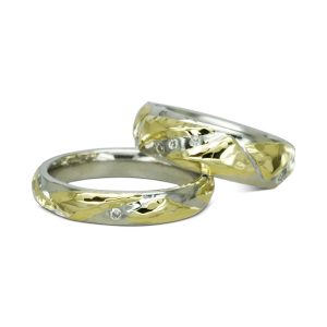 Two colour gold hammered wedding bands with diamonds